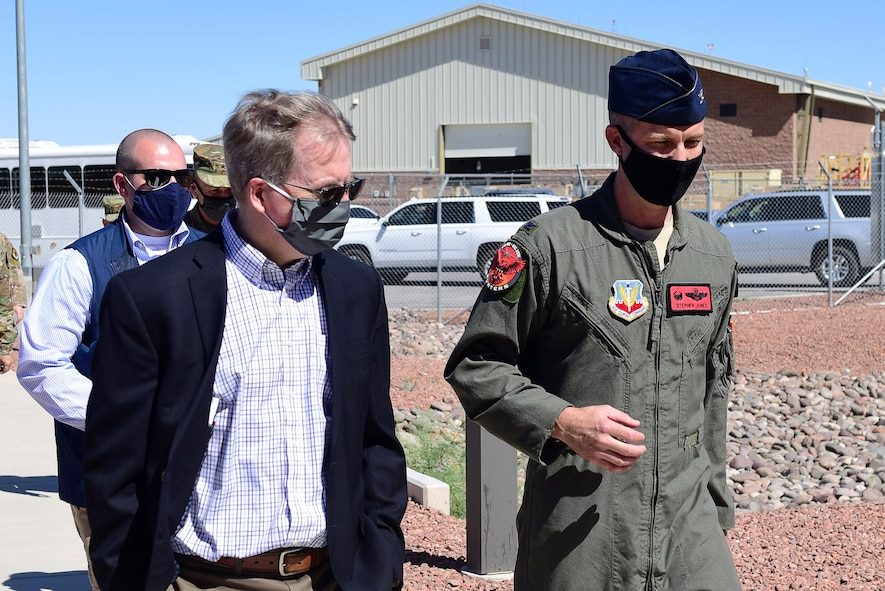 U.S. Deputy Secretary of Defense David L. Norquist walks alongside Col. Stephen R. Jones, 432nd Wing/432nd Air Expeditionary Wing commander, during a visit to Creech Air Force Base.