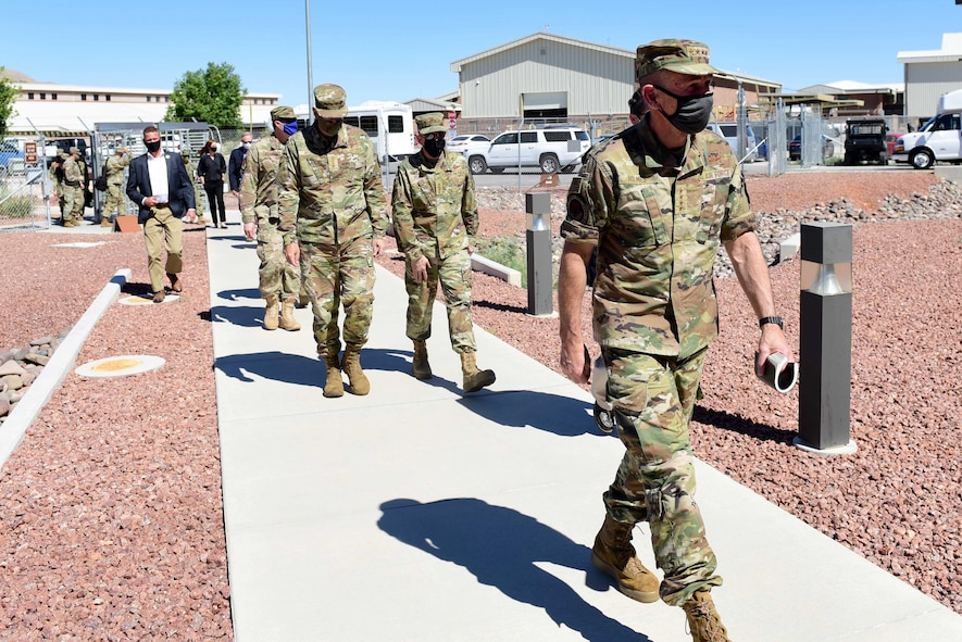 Gen. James M. Holmes, commander of Air Combat Command, approaches the 30th Reconnaissance Squadron, followed by senior leaders such as Gen. John E. Hyten, Vice Chairman of the Joint Chiefs of Staff, and Gen. Gen. Stephen W. Wilson, Vice Chief of Staff of the Air Force, during a visit at Creech Air Force Base, Nevada.