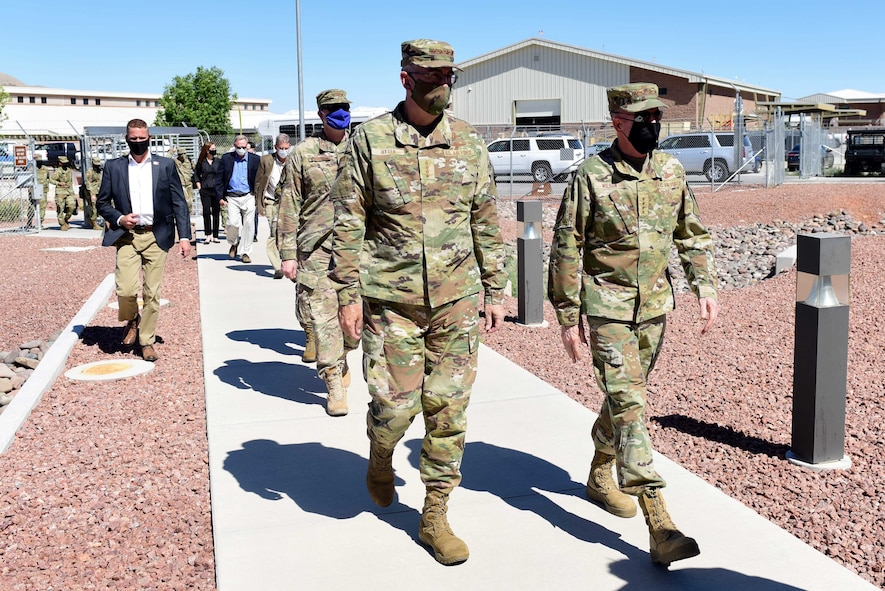 Gen. John E. Hyten, Vice Chairman of the Joint Chiefs of Staff, and Gen. Stephen W. Wilson, Vice Chief of Staff of the Air Force, approach the 30th Reconnaissance Squadron during a visit at Creech Air Force Base, Nevada