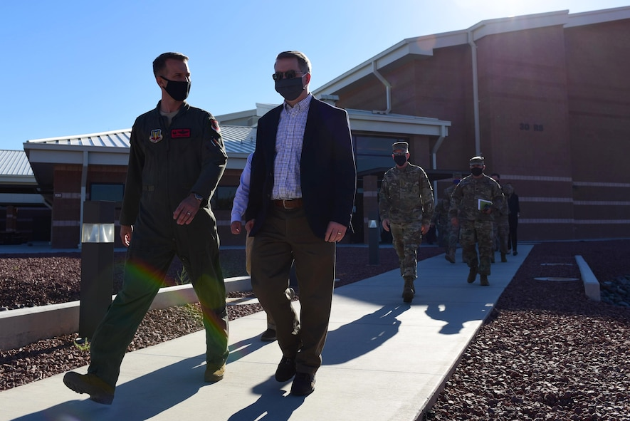 Col. Stephen R. Jones, 432nd Wing/432nd Air Expeditionary Wing commander, escorts U.S. Deputy Secretary of Defense David L. Norquist while departing Creech Air Force Base.