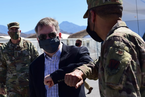 U.S. Deputy Secretary of Defense David L. Norquist walks alongside Col. Stephen R. Jones, 432nd Wing/432nd Air Expeditionary Wing commander, during a visit to Creech Air Force Base, Nevada.