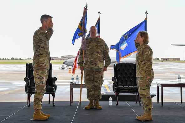 Col. Emily Farkas, incoming 22nd Maintenance Group commander, right, assumes command during a change of command ceremony July 9, 2020, at McConnell Air Force Base, Kansas.