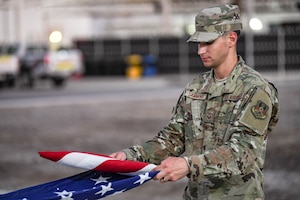 Staff Sgt. Seth Sammons, 380th Expeditionary Civil Engineering Squadron, practices flag folding as a part of the honor guard program.