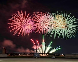 Fireworks explode behind a C-130J Super Hercules at Yokota Air Base, Japan, July 2, 2020.