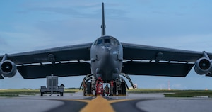 Airmen perform maintenance on a B-52H Stratofortress bomber deployed from Barksdale Air Force Base, La., after it landed at Andersen Air Force Base, Guam, July 4, 2020.