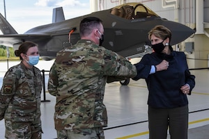 354th Aircraft Maintenance Squadron F-35A Lightning II production superintendent, bumps elbows with Secretary of the Air Force