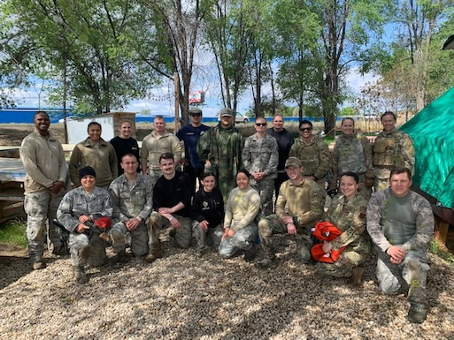 U.S. Air Force Airmen take a group photo after a combat medical care exercise near Mountain Home Air Force Base, Idaho. The 366th Operations Medical Readiness Squadron created a field response training program to ensure Air Force medics receive realistic care-under-fire training so they're ready to save lives down-range. (Courtesy photo)