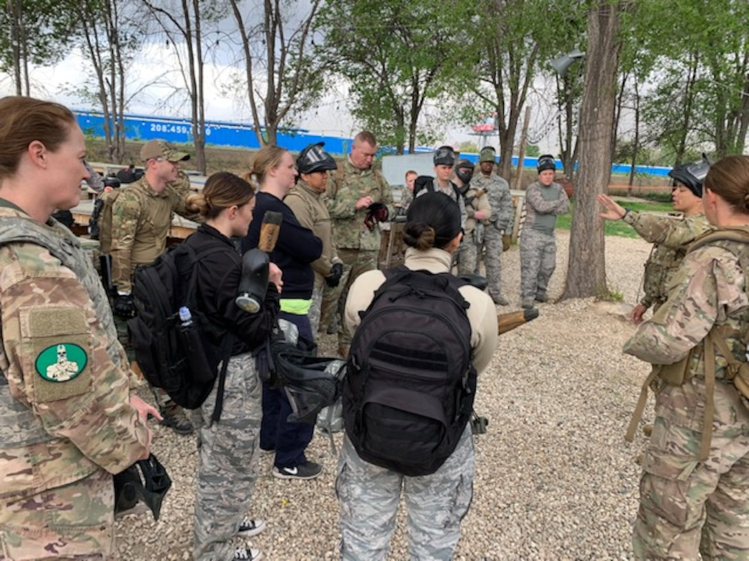 U.S. Air Force Airmen debrief after a combat medical care exercise near Mountain Home Air Force Base, Idaho. The 366th Operations Medical Readiness Squadron created a field response training program to ensure Air Force medics receive realistic care-under-fire training so they're ready to save lives down-range. (Courtesy photo)