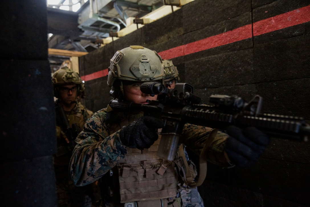 U.S. Marines clear a hallway during Close Quarters Tactics training at Camp Hansen, Okinawa, Japan, June 29.