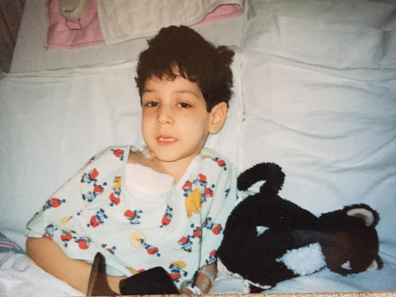 Airman 1st Class Isaiah A. Nieves, 2nd Maintenance Squadron aerospace ground equipment journeyman, sits in a hospital bed as a child. Nieves was diagnosed with Acute Lymphoblastic Leukemia at the age of four. (Courtesy photo)