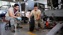 Senior Airman Benjamin A. Malian, 2nd Maintenance Squadron aerospace ground equipment craftsman, and Airman 1st Class Isaiah E. Nieves, 2nd MXS AGE journeyman, replace a tire on a -95 start cart at Barksdale Air Force Base, La., June 10, 2020. Second MXS AGE mechanics maintain and repair all the equipment that is used to service Barksdale's B-52H Stratofortresses. (U.S. Air Force photo by Airman 1st Class Jacob B. Wrightsman)