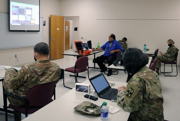 Soldiers from the 627th Hospital Center, Fort Carson, Colorado, attend data entry and input training as part of their assignment with Urban Augmentation Medical Task Force-627 at the Rudder U.S. Army Reserve Center at Joint Base San Antonio-Fort Sam Houston July 8.