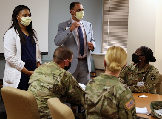 Soldiers from the Urban Augmentation Medical Task Force-627 are briefed by Chadi Awao, Chief Nursing Officer, and Ashley Holmstrom, Assistant Chief Nursing Officer, during integration and training at the Metropolitan Methodist Hospital in San Antonio July 8.