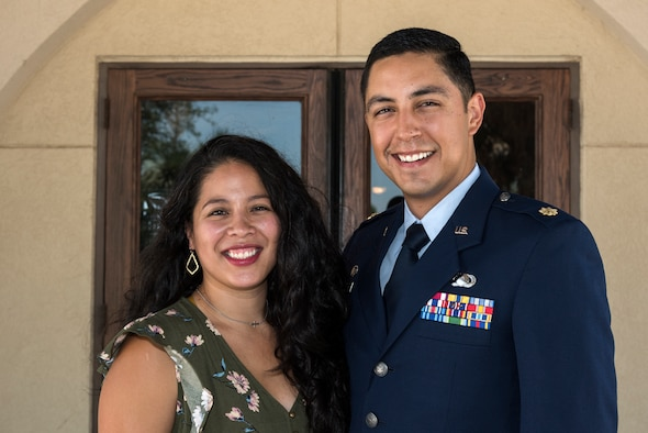 Maj. Aaron Velasco, 47th Contracting Flight commander, and his wife, Jackie, pose for a photo after the change of command July 10, 2020, at Laughlin Air Force Base, Texas. The Velasco family hails from San Antonio, where he was a flight commander in at Basic Military Training. (U.S. Air Force photo by Senior Airman Anne McCready)