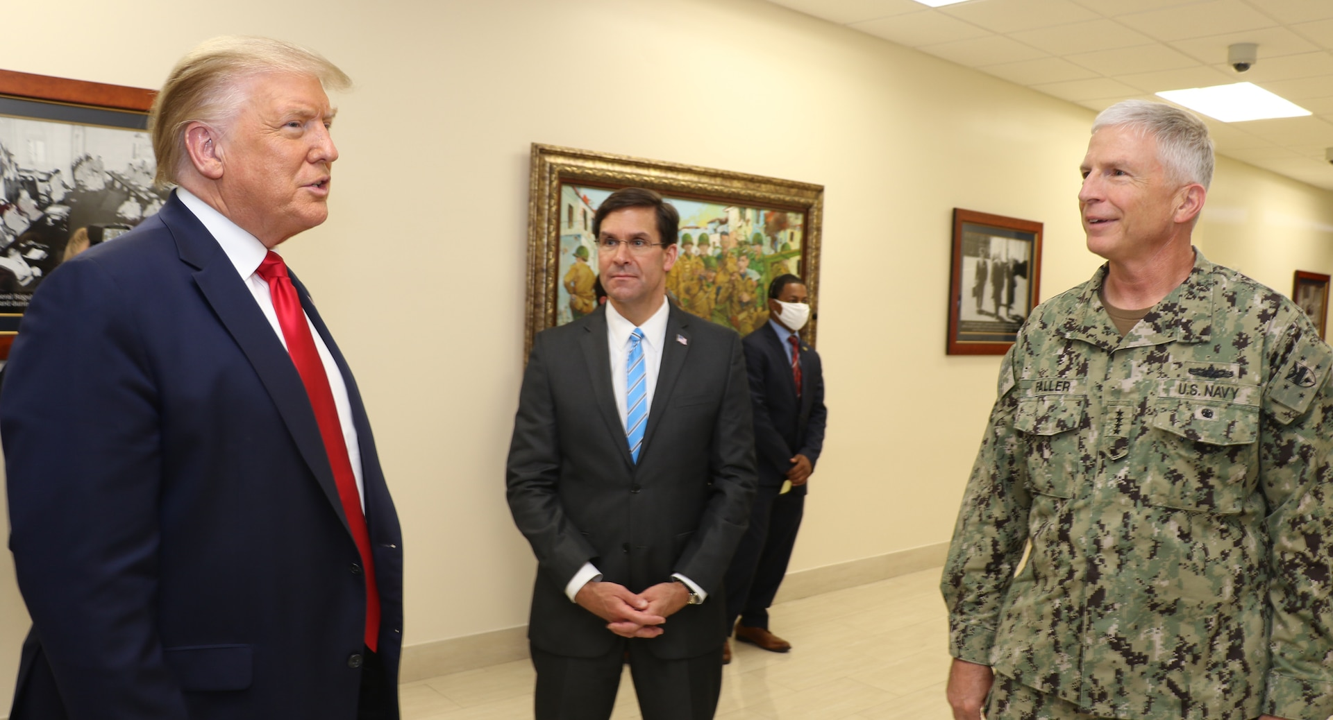 President Donald J. Trump talks with Defense Secretary Dr. Mark T. Esper and Navy Adm. Craig Faller, commander of U.S. Southern Command, at SOUTHCOM headquarters in Doral, Florida.