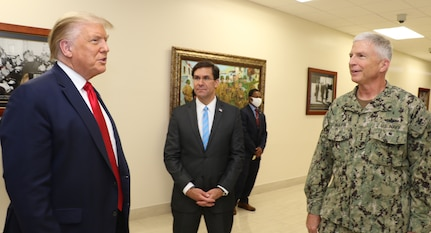 President Donald J. Trump talks with Defense Secretary Dr. Mark T. Esper and Navy Adm. Craig Faller, commander of U.S. Southern Command, at SOUTHCOM headquarters in Doral, Florida.