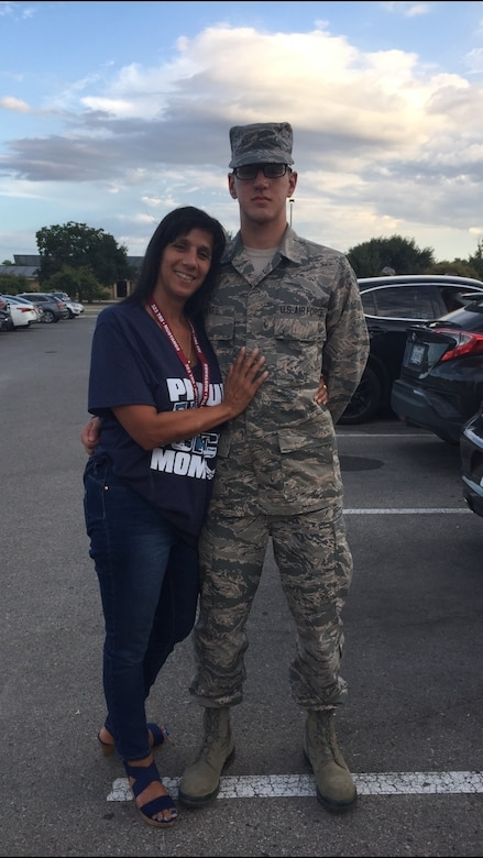 Airman 1st Class Isaiah A. Nieves, 2nd Maintenance Squadron aerospace ground equipment journeyman, stands with his mother, Idalia Cruz, after his Basic Military Training graduation at Lackland Air Force Base, Texas. Nieves joined the Air Force in July 2019, and arrived at Barksdale in March 2020. (Courtesy photo)