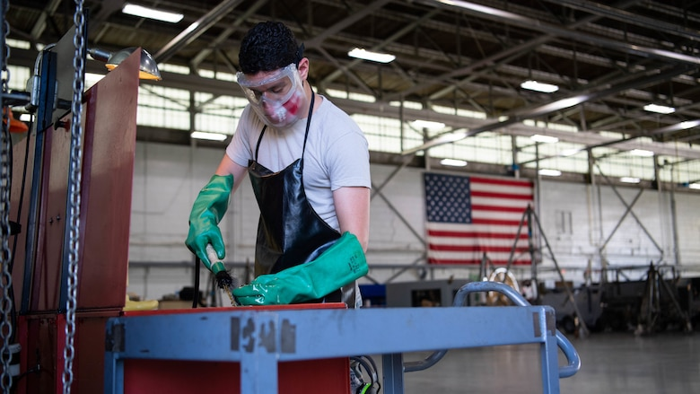 Airman 1st Class Isaiah E. Nieves, 2nd Maintenance Squadron aerospace ground equipment journeyman, cleans mechanical parts at Barksdale Air Force Base, La., June 10, 2020. Nieves joined the Air Force in July 2019, and arrived at Barksdale in March 2020. (U.S. Air Force photo by Airman 1st Class Jacob B. Wrightsman)
