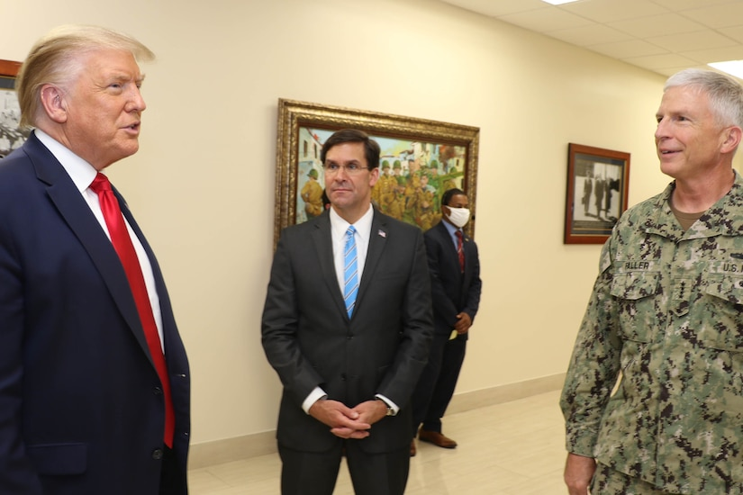 President Donald J. Trump talks with Defense Secretary Dr. Mark T. Esper and Navy Adm. Craig Faller, commander of U.S. Southern Command.