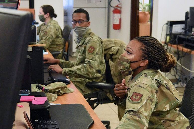 Senior Airman Mary Graham (left), Airman 1st Class Jordan Grant (middle), and Senior Airman Tiarra Chavis (right), resolve troubleshooting tickets at Aviano Air Base, Italy, July 9, 2020. The Airmen are 31st Communications Squadron client systems technicians who  overcame unique challenges to support the 31st Fighter Wing. (U.S. Air Force photo by Staff Sgt. Heidi Goodsell)