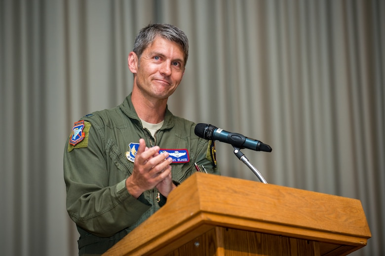 Col. Ryan Blake, the former Test Pilot School Commandant, provides his farewell remarks during a Change of Command ceremony at Edwards Air Force Base, California, July 10. (Air Force photo by Ethan Wagner)