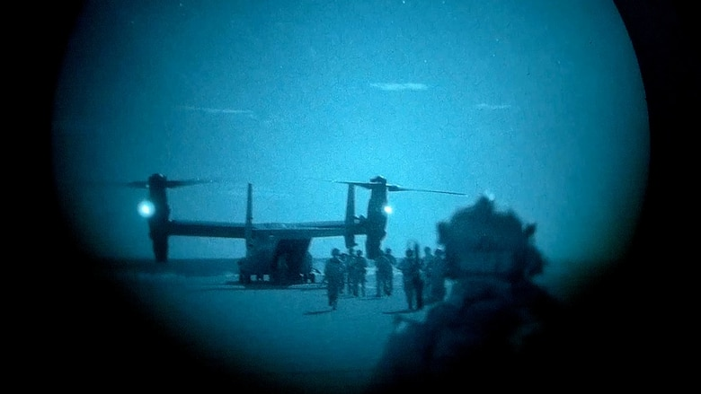 Air Force Special Tactics operators and simulated partner forces load a CV-22 Osprey,