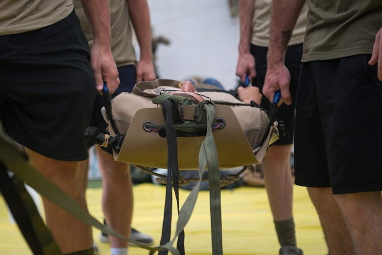 Simulated partner forces learn how to package and transfer patients using a portable stretcher
