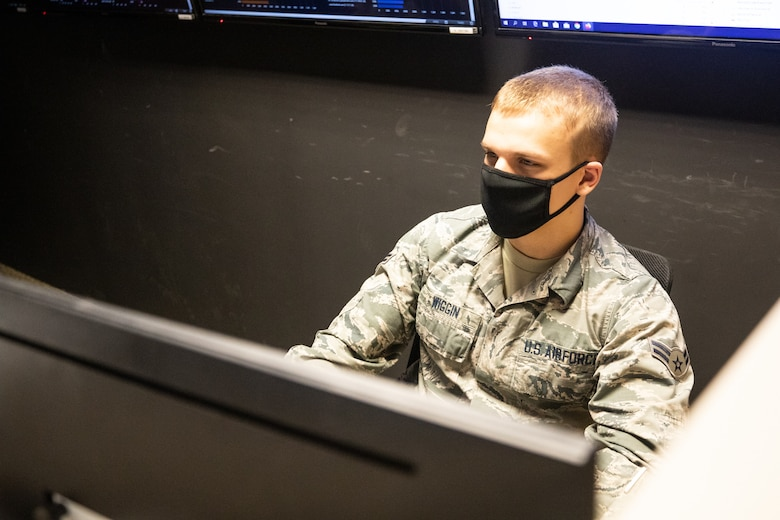 In support of COVID-19 relief operations for the state's department of information technology, Airman 1st Class Noah Wiggin, an IT specialist with 157th Air Refueling Wing Communication Flight, configures dashboards in Concord on May 26, 2020.