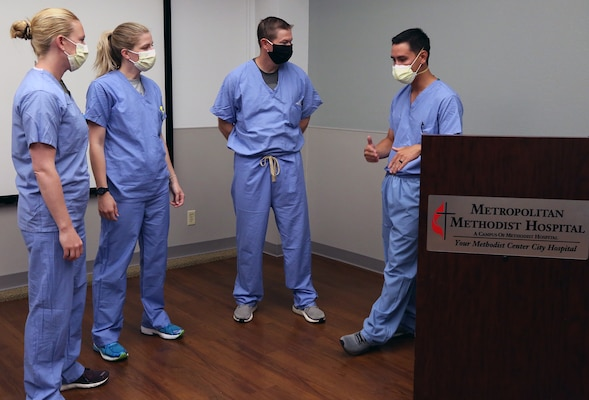 Soldiers from the Urban Augmentation Medical Task Force-627 begin supporting Methodist Hospital medical staff in San Antonio July 9.