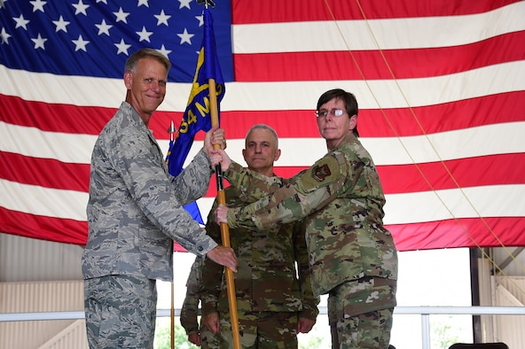 Col. Gretchen Wiltse, 434th Mission Support Group commander, receives the guidon from Col. Larry Shaw, 434th Air Refueling Wing commander, during a change of command ceremony at Grissom Air Reserve Base, Indiana July. 9, 2020. Wiltse joins MSG from Grissom's maintenance group, where she also served as the group commander. 