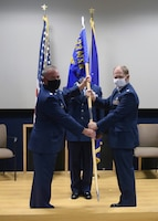 Lt. Col. Stuart Martin, 433rd Maintenance Group commander, presents the guidon to Lt. Col. A. Spence Pennington, 433rd Aircraft Maintenance Squadron commander, at a change of command ceremony for the 433rd AMXS July 11, 2020 at Joint Base San Antonio-Lackland, Texas.