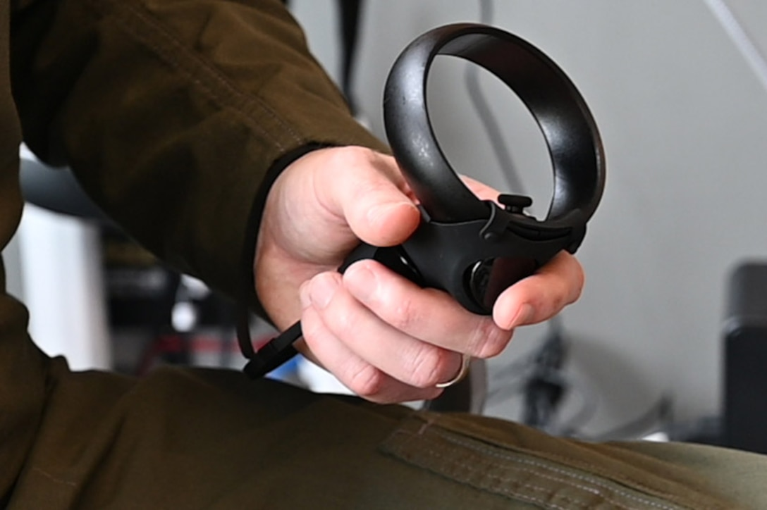 An Airman works a virtual reality trainer