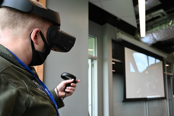 An Airman practices with a virtual reality trainer.