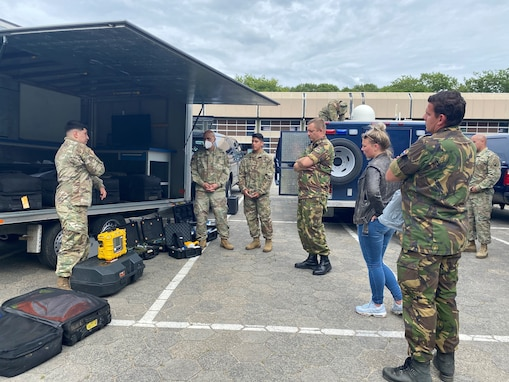 U.S Army Reserve Staff Sgt. William Haynes, survey team member with the 773rd Civil Support Team, 7th Mission Support Command, briefs chemical detection capabilities to Dutch Soldiers in Vught, Netherlands, July 7, 2020. The one-day CBRN situational training exercise focused on a CBRN incident on a maritime vessel at the Dutch Harbor in Gravendeel, Netherlands.  (U.S Army Reserve Photo by Capt. Lorenzo Llorente).