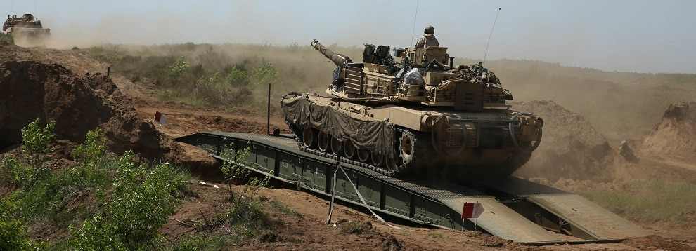 U.S. Soldiers maneuver an M1A1 Abrams Main Battle Tank across an Armored Vehicle Launched Bridge during exercise Allied Spirit at Drawsko Pomorskie Training Area, Poland, June 13, 2020. (U.S. Army photo by Sgt. Randis Monroe)