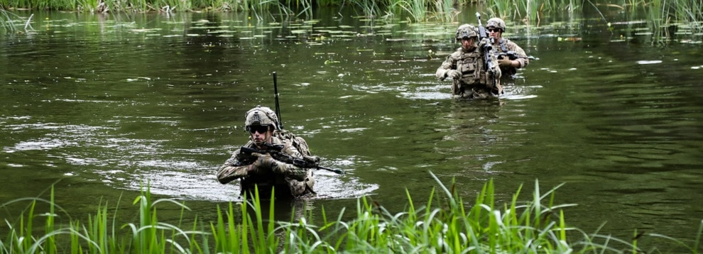 U.S. Soldiers with the 6th Cavalry Regiment cross a river to reach an objective during exercise Allied Spirit at Drawsko Pomorskie Training Area in Poland, June 10, 2020. (U.S. Army photo by Sgt. Meagan Mooney)