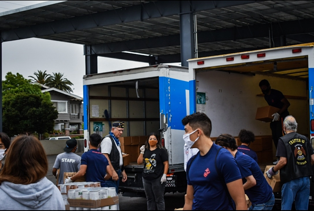 Marine recruiters and future Marines with Recruiting Sub-Station Burbank, Recruiting Station Los Angeles, prepare and sort donated food while volunteering for the Justin and Kourtney Turner Food Bank in Los Angeles, June 20.