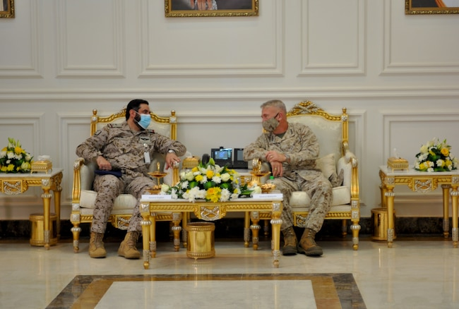 U.S. Marine Corps Gen Frank McKenzie, CDR, U.S. Central Command sits with Saudi Arabian Maj. Gen. Khalid bin Abdullah AlShablan, commander, Prince Sultan Air Base, during a visit to Prince Sultan Air Base, Kingdom of Saudi Arabia, July 9, 2020. During the visit, Gen McKenzie was able to visit with Soldiers, Marines, and Airmen around the base and see how Prince Sultan Air Base is sustaining and defending its region in CENTCOM's area of responsibility. (U.S. Air Force Photo by Capt. Tisha Yates).