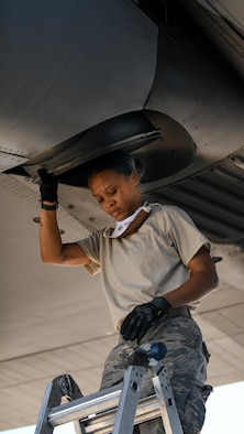Senior Airman Dayna Jones, a crew chief with the 910th Maintenance Squadron, steps down from a ladder after performing a thru-flight inspection on a C-130H Hercules on Youngstown Air Reserve Station's flightline, July 7, 2020. Crew chiefs use thru-flight inspections to search for any loose, broken or corroded parts and foreign material prior to takeoff.