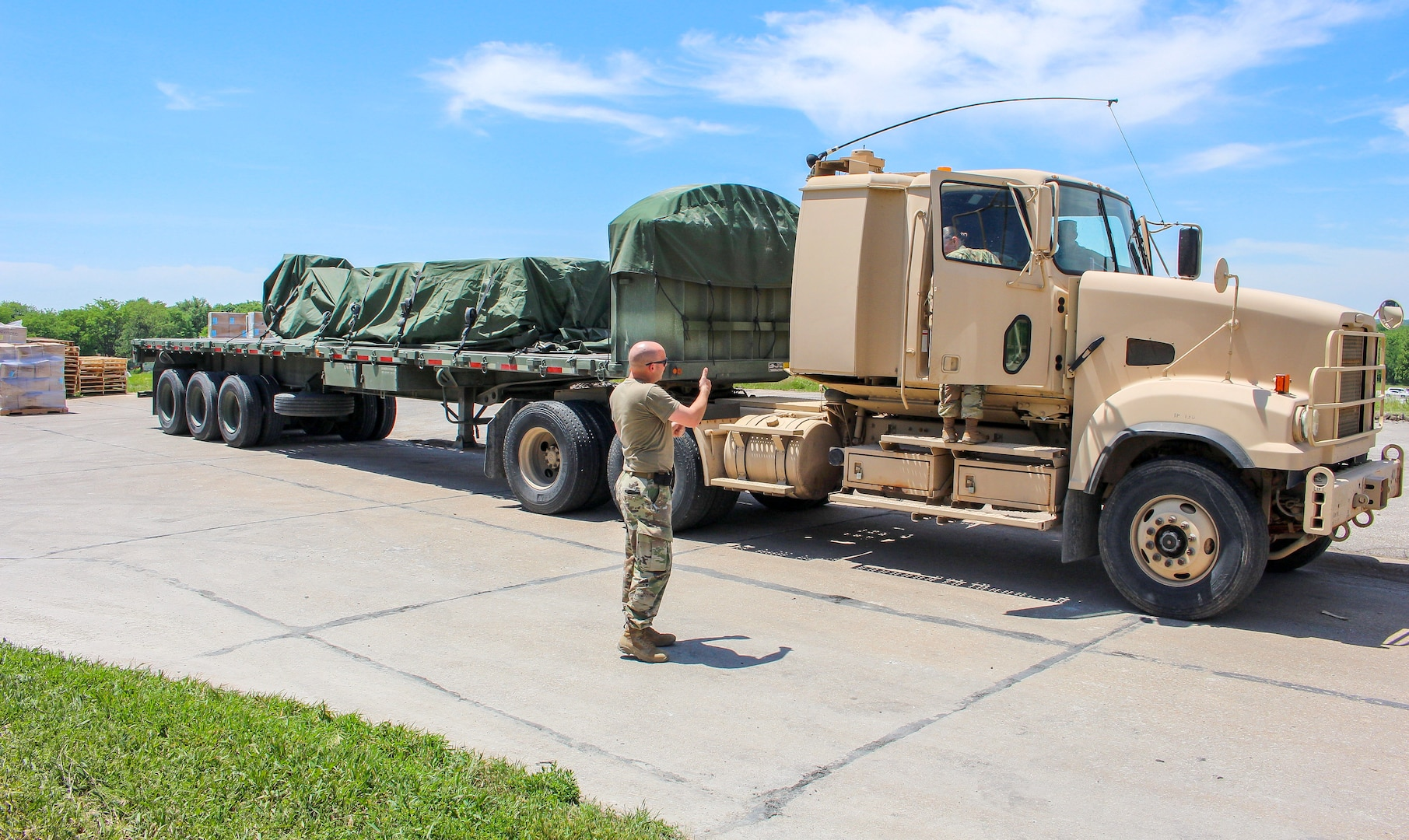 Nebraska Army National Guard Soldiers move personal protective equipment from a warehouse June 2, 2020, in Lincoln, Nebraska. The Nebraska National Guard delivered PPE across the state to all the local health departments.
