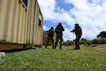 Airmen assigned to the 736th Security Forces Squadron participate in a simulated live fire scenario, conducting close quarters and urban combat training at the Pacific Regional Training Center near Andersen Air Force Base, Guam, June 11, 2020. During the scenario, participants were split into teams, using the training opportunity to build trust and camaraderie between team members and applying real-life situations in order to increase combat readiness and interoperability.