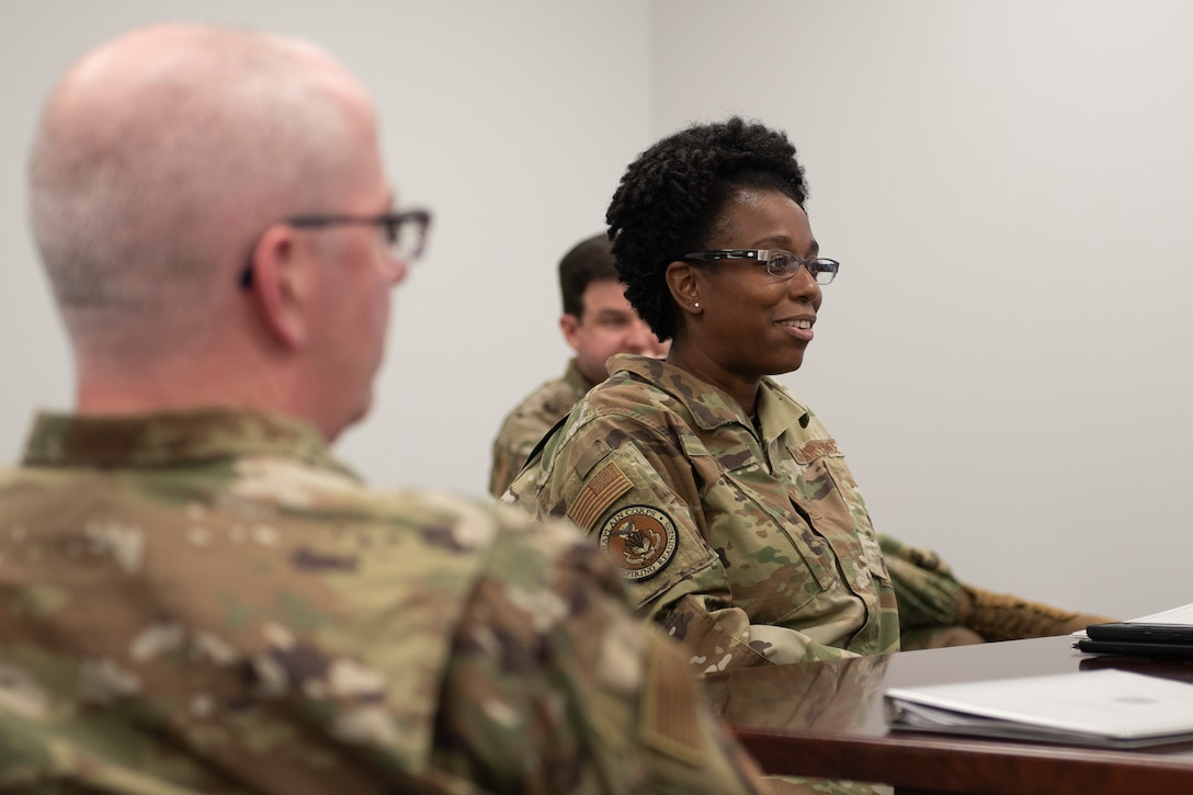 Photo of a Chief Master Sergeant smiling.