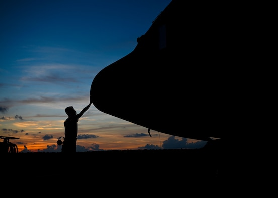 An Airman touches the nose of a C-130J Super Hercules.