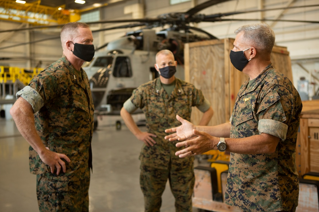 U.S. Marine Corps Col. Curtis Ebitz, commanding officer of Marine Corps Air Station New River, and Lt. Col. Roger Holliday, director of MCAS New River installations and environment, escort Maj. Gen. Edward D. Banta, commanding general of Marine Corps Installations Command, through hangar AS-4109 on MCAS New River, July 13, 2020. Banta is visiting military installations in Eastern North Carolina to receive an update on military construction from installation leaders and view hurricane related repairs to facilities and family housing currently in progress. (U.S. Marine Corps photo by Sgt. Breanna Weisenberger)