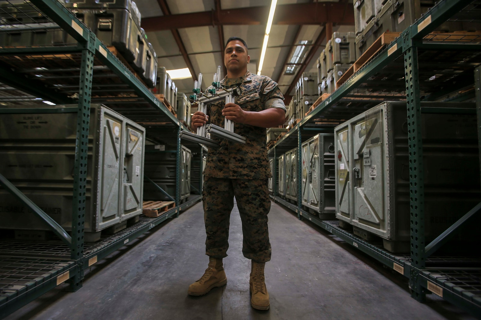 Staff Sgt. Victor Cervantes, the Digital Manufacturing Platoon staff non-commissioned officer in charge with Ordnance Maintenance Company, 1st Maintenance Battalion, 1st Marine Logistics Group, developed an oxygen manifold to help ease the burden on medical staff on Camp Pendleton, California, June 25, 2020. For his role in the development and fabrication of an efficient oxygen manifold that can provide oxygen to multiple patients from one tank, Cervantes received the 1st MLG Innovation Award from 1st MLG Commanding General Brig. Gen. Bobbi Shea. (U.S. Marine Corps photo by Pfc. Ulises Salgado)