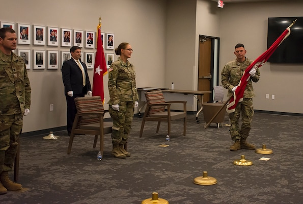 Lt. Col. Larry Caswell hands over command of the Albuquerque District, symbolized in the passing of the USACE flag, during the change of command ceremony at the district's office, July 9, 2020.
