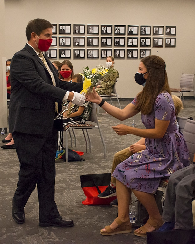 John Drake, Albuquerque District deputy district engineer, presents yellow roses to Patricia Stevens, wife of incoming district commander Lt. Col. Stevens, during the change of command ceremony, July 9, 2020, at the district office. Yellow is a sign of welcome and new beginnings. The budding flowers represent the anticipation of things to come.
