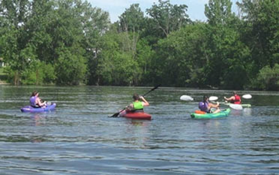 Paddle boaters enjoy a day on the lake.