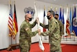 Col. Doug LeVien, right, passes the U.S. Army Medical Materiel Center-Europe's colors to incoming commander, Col. Shane Roach, during a Change of Command ceremony on July 9. Outgoing commander Col. Jonathan B. Butler is pictured on the right. LeVien, deputy commander of 21st Theater Sustainment Command, served as the representative for Col. Michael Lalor, commander of Army Medical Logistics Command. Lalor presided over the ceremony remotely from Fort Detrick, Maryland.