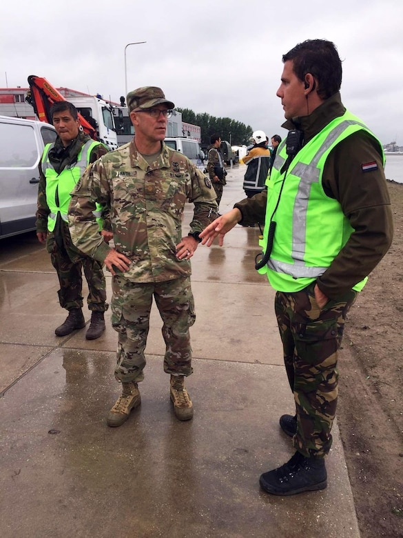 U.S Army Reserve Maj. Blair Heath, medical officer with the 773rd Civil Support Team, 7th Mission Support Command, left, back briefs Netherlands Captain Tom Martens, Netherlands CBRN Defense Centrum Operations Officer, on the medical monitoring status of the 773rd Civil Support Team's survey team during a training exercise in Gravendeel, Netherlands, July 8. The one-day CBRN situational training exercise focused on a CBRN incident on a maritime vessel at the Dutch Harbor in Gravendeel, Netherlands.  (U.S Army Reserve Photo by 1st Sgt. Domenic Barbeiro).